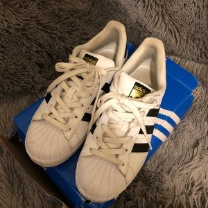 Women's black and white shell toe Adidas